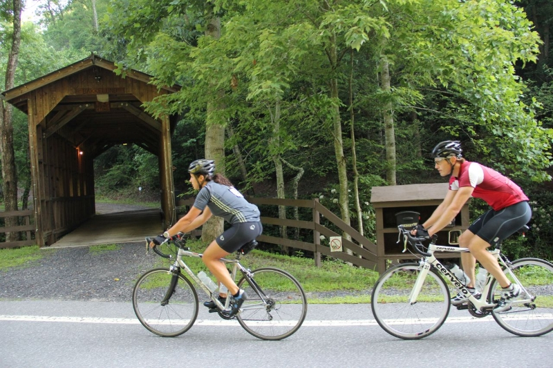 Cyclists and Covered Bridge