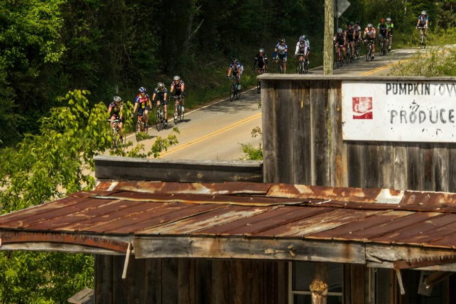 riders pass historic country store on bike Tour of the Carolinas