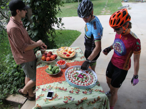 Riders enjoy fresh snacks along their cycling adventure