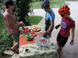 Riders enjoy fresh snacks along their cycling adventure