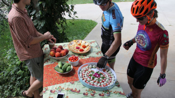 Cyclists stop to sample cheese at a farm along the Black Mountain cycle to farm route