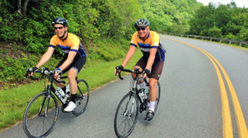 Cyclists on the Elk Mountain Scenic Loop route wearing the Velo Girl Rides Blue Ridge Parkway jersey