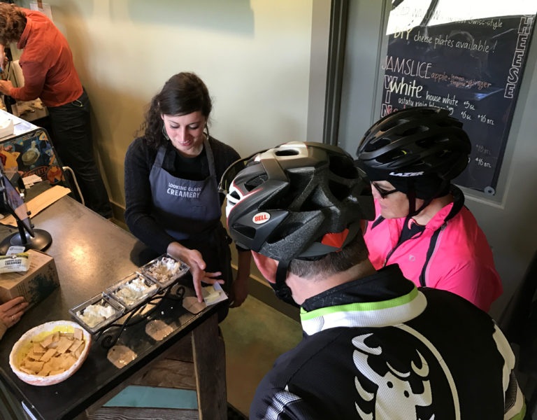 Cyclists visiting Looking Glass Creamery cheese shop